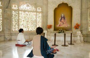 Devotees meditating in Smriti Mandir