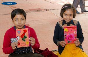 Children show their hand made cards.