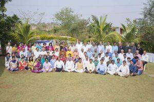 Nashik devotees gather for a group photo with the monastics.