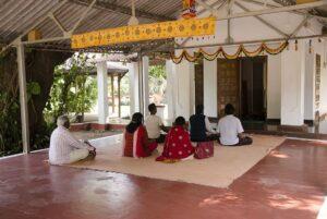 Devotees have personal meditation at Shiva Mandir.