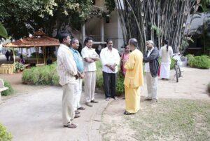 Brahmachari Achyutananda speaks with a group of devotees.