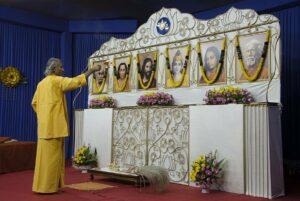 Brahmachari Dhairyananda performs aarti before evening meditation.