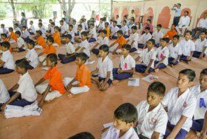Children engrossed in meditation.