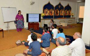 A volunteer makes Maths interesting in Vedic Mathematics class.