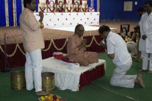 Swami Madhavananda distributes prasad at the closing ceremony.
