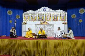 Brahmachari Achyutananda leads Cosmic Chants and bhajan during long meditation.
