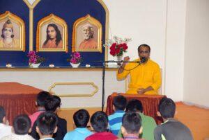 Brahmachari Sheelananda takes a class on Energization Exercises.