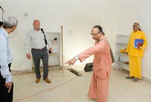 Swami Ishwarananda discusses the layout of the printing press room.