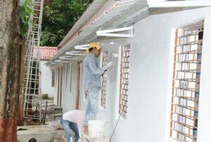 Walls receive a new coat of paint.