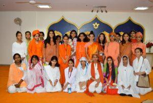 Girls enact as various saints of India.