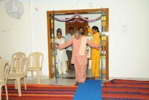 Swami Smaranananda opens doors of the new Dhyana Mandir, Anantapur.