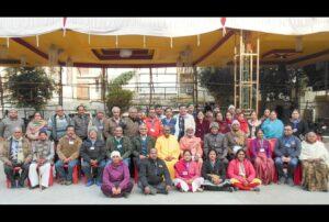 Swami Hiteshananda and Brahmachari Swarupananda with Kanpur devotees.