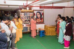 Swami Hiteshananda inaugurates the book stall.