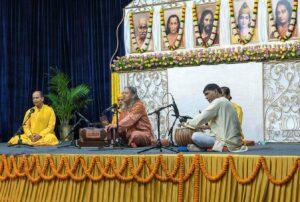 Swami Vasudevananda leads bhajan.