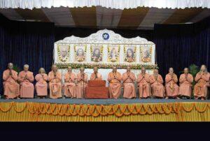 Swami Smaranananda leads the prayer.
