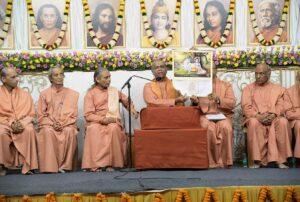 Swamiji displays the 2019 YSS calendar.