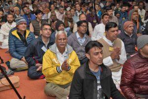 Devotees join in devotional chanting.