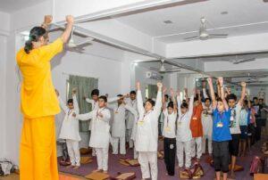 Brahmachari Alokananda leads the Energization Exercises.