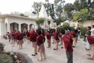 Children practice Energization Exercises before group meditation.