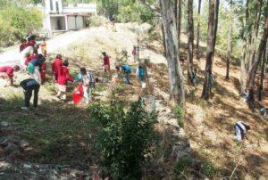 Cleaning the ashram neighbourhood.