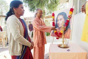 Swami Lalitananda lights the lamp.