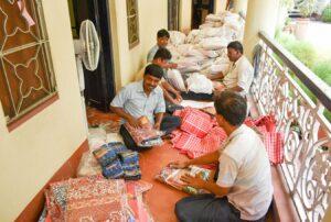 Volunteers help to make parcels for distribution, Dakshineswar.