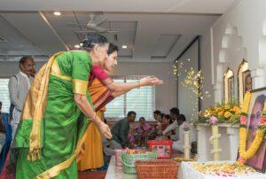 Devotees offer flowers.