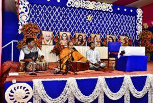 Brahmachari Achyutananda sings bhajan, Dakshineswar.