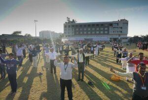 Devotees practise group Energization Exercises, Indore.