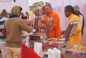 Monks serve prasad after diksha ceremony, Indore.
