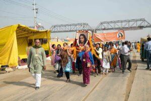 Devotees carry palanquin during Prabhat Feri.
