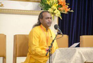 Brahmachari Sheelananda makes the announcements.