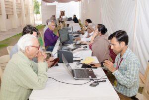 Devotees register for the Sangam.