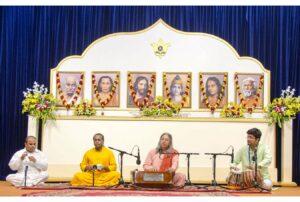 Swami Vasudevananda leads bhajan session.