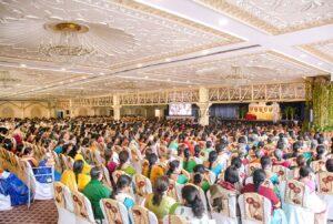 Devotees listen to a talk on Guruji's teachings.