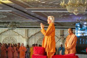 Swami Chidananda pranams to devotees after his talk.