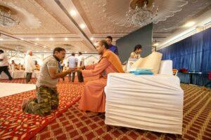 Swami Kamalananda distributes prasad.
