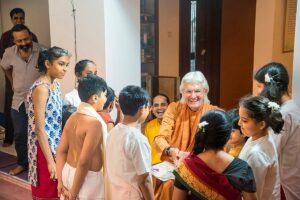 Children greet Swamiji after performing a skit based on Gurudeva's story on the saint Sri Chaitanya .
