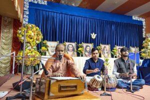 Swami Achyutananda leads chanting.