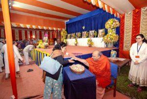 Swami Amarananda distributes prasad.