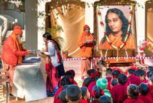 Swami Nityananda distributes gifts.