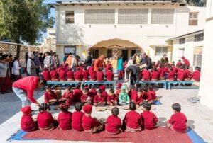 Students are served prasad.