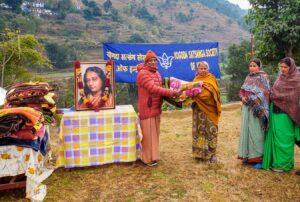Swami Madhavananda distributes blankets, Dwarahat.