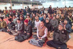 Devotees join in chanting, Noida.