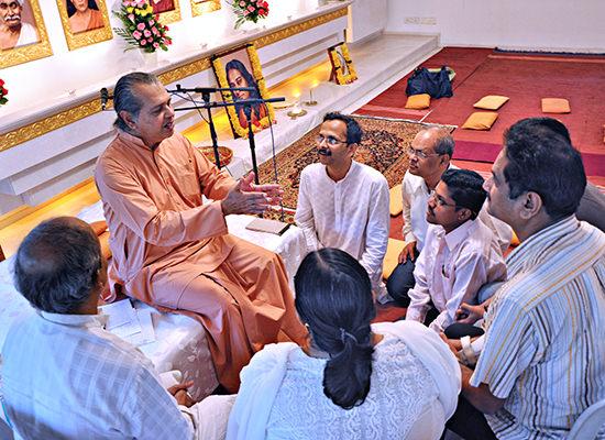 Shraddhananda with devotees discussing Yogananda's teachings.