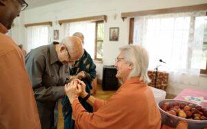 Swamiji blesses a sevak couple.