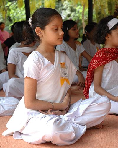 Girl child meditating.