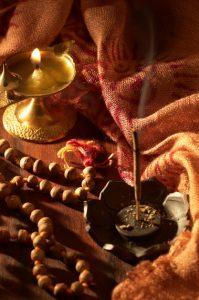 Diya and incense used in prayers.