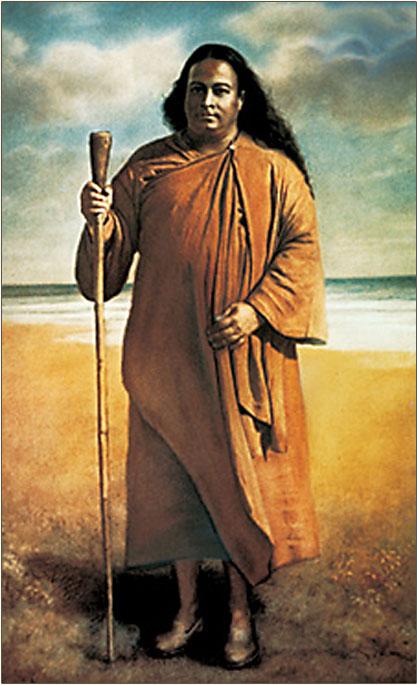 Paramahansa Yogananda standing on a seashore