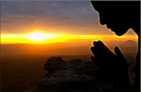 Praying during sunset.